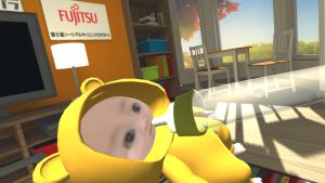 Photo03:「Real Baby - Real Family」体験中、哺乳瓶からミルクをあげています。赤ちゃんが笑い、手には振動が伝わります。